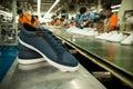 Sneaker shoe canvas in a footwear factory line Royalty Free Stock Photo