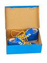 Sneakers in box isolated on white background Stock Photos