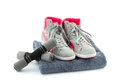 Sneakers with dumbbells and towel grey dumbells on a grey Royalty Free Stock Photos