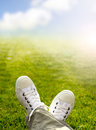Sneakers in the grass with and sky background Stock Images