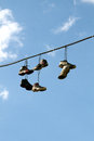 Sneakers Hanging on a Telephone Line Royalty Free Stock Photo