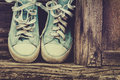Sneakers old on the wood Royalty Free Stock Images