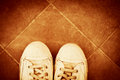 Sneakers pair of from above on tiles retro colors Royalty Free Stock Photography