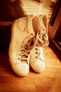 Sneakers pair of leaned on door retro colors Stock Photos