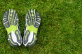 Sneakers soles on grass with space right Stock Images