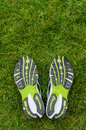 Sneakers soles on grass with space top Royalty Free Stock Images