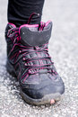 sneakers Standing on the road .mountain shoes Royalty Free Stock Photo