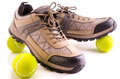 Sneakers and tennis balls on white background Stock Image