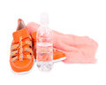 Sneakers, a towel and a bottle of water  Royalty Free Stock Photos