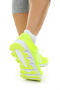 Sneakers on women legs Royalty Free Stock Photo