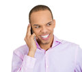 Sneaky on cellphone closeup portrait sly scheming young man trying to plot something screw someone phone isolated white background Royalty Free Stock Images