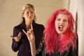 Sneering Parent and Loud Daughter Royalty Free Stock Photo