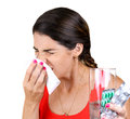 Sneezing closeup of caucasian woman with cold into tissue Stock Images