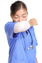 Sneezing woman medical nurse or doctor doing elbow sneeze being sick having the cold flu sneezing instruction concept with person Royalty Free Stock Photography