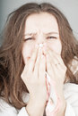 Sneezing young attractive woman Royalty Free Stock Photography