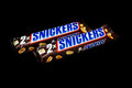 Snickers candy bar zagreb croatia january chocolate on black background product shot Stock Images