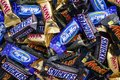 Snickers, Mars, Milky Way and Twix minis candy bars. Royalty Free Stock Photo
