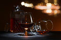 Snifter with brandy on black wooden table Stock Image