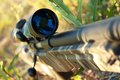 Sniper rifle bolt action with telescopic sight closeup shallow dof Royalty Free Stock Images