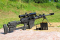 Sniper rifle caliber bmg with ammo on shooting range Royalty Free Stock Image