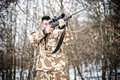 Sniper with weapon ready for combat or hunting in the forest Royalty Free Stock Photo