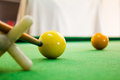 Snooker balls with cue on green pool table Stock Images