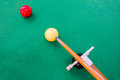 Snooker balls with cue on green pool table Stock Photography