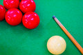 Snooker balls with cue on green pool table Royalty Free Stock Images
