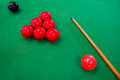 Snooker balls with cue on green pool table Stock Image
