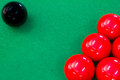 Snooker balls on green pool table Royalty Free Stock Images