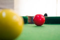Snooker balls on green pool table Stock Photography
