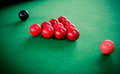 Snooker table and snooker balls on table in a playing room Royalty Free Stock Images