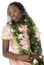 Snooty a flower bedecked tween girl appearing as she looks down on the viewer on a white background Royalty Free Stock Image
