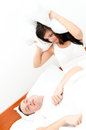 Snoring man couple in bed men and women can not sleep Stock Photos