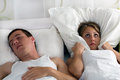 Snoring man and young woman men couple sleeping in bed Royalty Free Stock Image