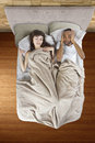 Snoring partner unable to sleep in bed because of Stock Photos