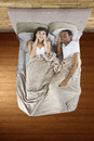 Snoring partner unable to sleep in bed because of Stock Photography