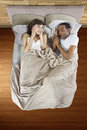 Snoring partner unable to sleep in bed because of Royalty Free Stock Image
