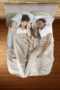 Snoring partner unable to sleep in bed because of Royalty Free Stock Images