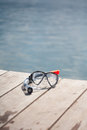 Snorkel equipment in front of water Stock Image