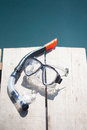 Snorkel equipment in front of water Royalty Free Stock Photo