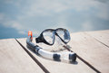 Snorkel equipment in front of water on resort Stock Photo