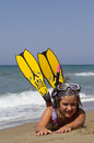 Snorkeler girl posing on a beach wearing snorkeling equipment Stock Image