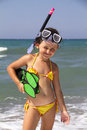 Snorkeler girl posing on a beach wearing snorkeling equipment Royalty Free Stock Images
