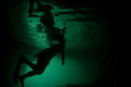 Snorkeler in submerged cave a explores an underwater raja ampat indonesia Stock Photos