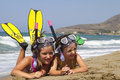 Snorkelers girls posing on a beach wearing snorkeling equipment Royalty Free Stock Photos