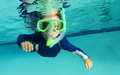 Snorkeling child in pool for recreation Royalty Free Stock Photo