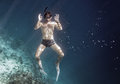 Snorkeling man is posing under the blue water Royalty Free Stock Photo