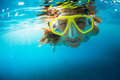 Snorkeling in the ocean close up shot of young lady clear tropical sea Royalty Free Stock Photo