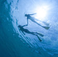 Snorkeling underwater view of the couple in the tropical sea Stock Image
